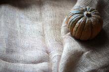 Close-up Of Pumpkin On Burlap