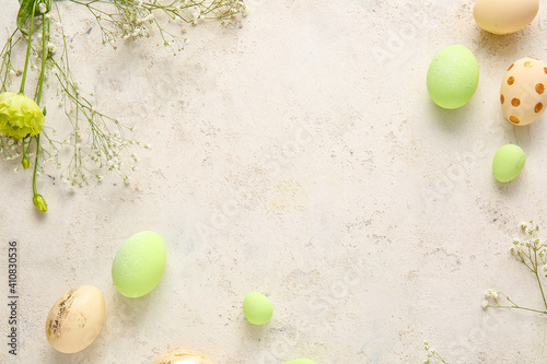 Photo Composition with beautiful Easter eggs on light background