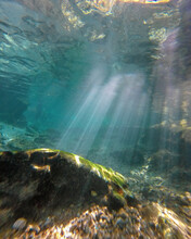 Rays Of Sunlight Under Blue Spring Water
