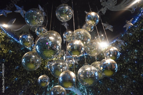 Fototapeta Low Angle View Of Illuminated Disco Balls Hanging On Ceiling obraz