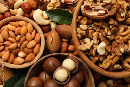 Fotografie, Obraz Wooden bowls with different nuts, close up