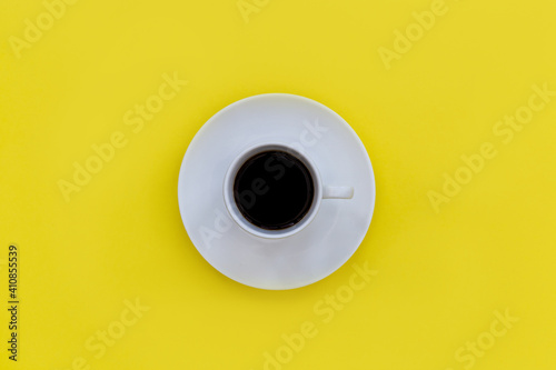 Fototapeta Directly Above Shot Of Black Coffee In Cup Over Yellow Background obraz