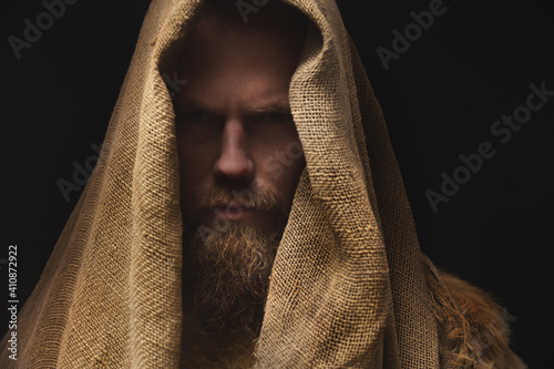 Canvas Print Portrait of a medieval bearded war monk dressed in animal skins and sacking