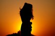 Leinwandbild Motiv Silhouette Woman Standing Against Orange Sky During Sunset