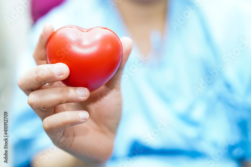 Midsection Of Woman Holding Heart Shape In Hospital