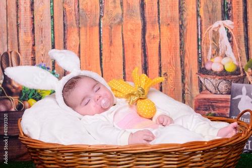Obraz Cute Baby Girl With Pacifier Sleeping In Basket - fototapety do salonu