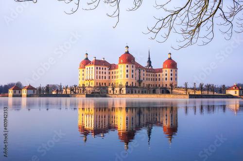 Moritzburg castle after sunrise at winter time, Germany