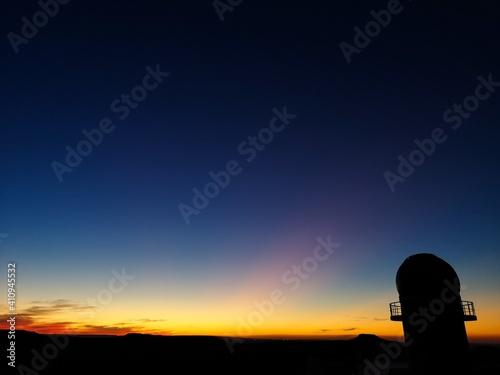 Obraz na płótnie Silhouette Built Structure Against Blue Sky At Sunset