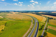Highway Under Blue Cloudy Sky Aerial View