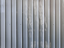 Full Frame White Corrugated Metal Wall Background With Light And Shade