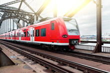 Train And Railway Tracks Closeup In Frankfurt - Regional Red Train In Germany With Empty Tracks On Foreground - Transport And Travel Concepts