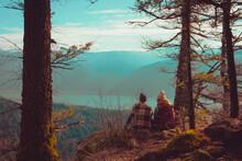 Couple Seated Overlooking Mountain Range