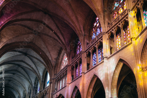 Inside the gothic St Cyr Ste Juliette Cathedral of Nevers, a city located in Burgundy, France. The stained glass windows are modern and were installed after WWII.