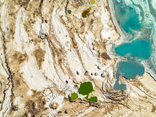 Aerial View Of Colorful Sinkholesat The Shores Of The Dead Sea, Jordan Rift Valley, Israel.