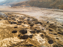 Aerial View The Sinkholes Phenomena And The Destruction It Caused At The Shore Near The Dead Sea. Jordan Rift Valley, Israel.