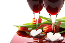 Valentine Decoration With Two Glasses Of Wine, White Hearts And Colorful Tulips On White Background