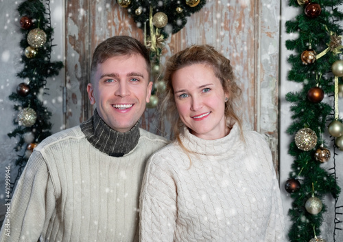 Couple portrait in Christmas decorations © Alexey Kuznetsov