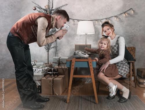 Retro family at home on Christmas day © Alexey Kuznetsov