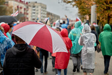 Belarus Belarus People Walk Under Umbrellas During A Peaceful Demonstration