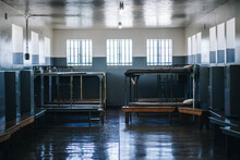 Perfectly Clean Prison Cell Metal Bunk Beds, Sitting Benches, And Wall Lockers