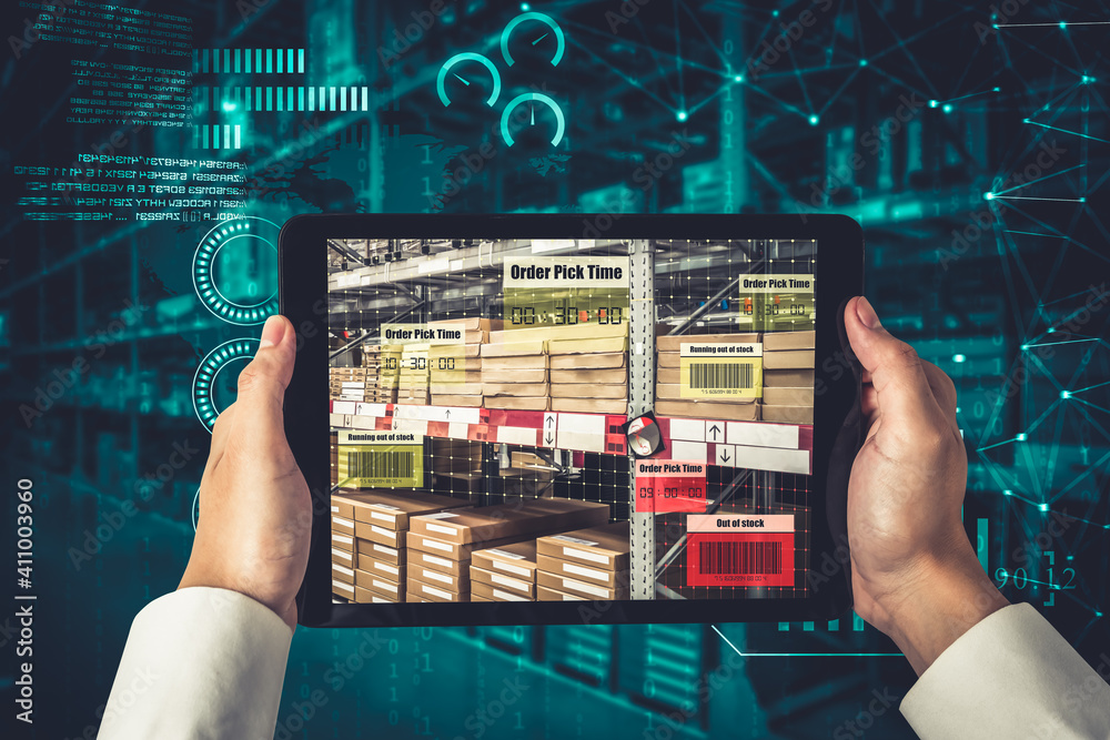 Fototapeta Smart warehouse management system using augmented reality technology to identify package picking and delivery . Future concept of supply chain and logistic business .