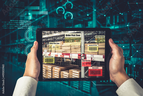 Fotografie, Obraz Smart warehouse management system using augmented reality technology to identify package picking and delivery