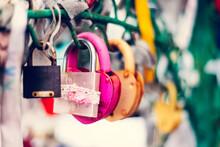 Many Bright, Colored  Iron  Love Romantic Padlocks, Wedding Padlocks, Love Locks. Symbol Of Eternal Love Hanging On The Railing. Together Forever
