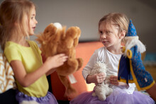 A Little Sisters Playing With Dolls At Home. Children, Home, Playing