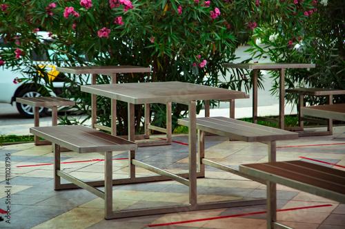 Fototapeta cozy summer cafe, restaurant, with a stylish interior and furniture obraz na płótnie