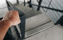 Close Up Of A Hand Holding A Railing