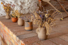 Several Antique Clay Flower Pots Stand In A Row On The Table