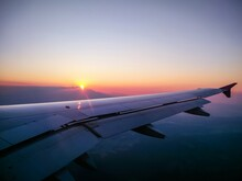 Close-up Of Airplane Wing Against Sky During Sunset