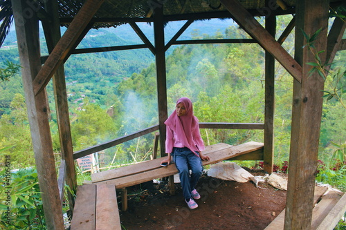 High Angle View Of Teenage Girl Sitting On Bench In Gazebo At Mountain Fototapet