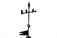 Bird Silhouette On Top Of An Iron Cross
