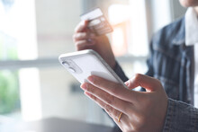 Mobile Banking, Online Shopping, Digital Banking, Internet Payment Concept. Woman Hand Using Mobile Smart Phone Payments And Credit Card For Online Shopping