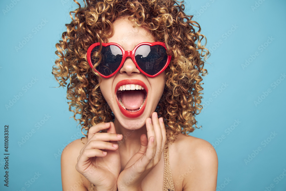 Fototapeta Cheerful woman Wearing dark glasses red lips open mouth look forward