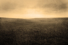 Stylized Foggy Grassland Background With Rolling Hills, Gritty Sepia Texture, And Blank Space
