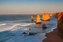 Rocks On Sea Shore Against Clear Sky