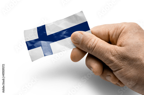 Hand holding a card with a national flag the Finland Fototapeta