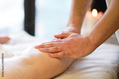 Obraz na plátně Detail of hands massaging human calf muscle