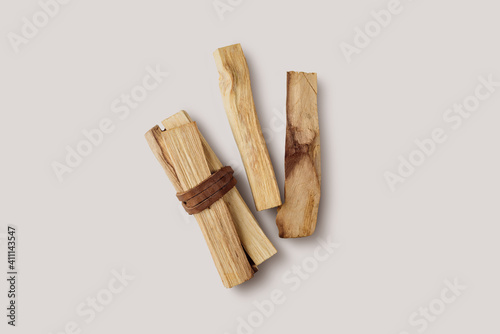 Fototapeta Palo Santo tree stick tied in bunches on a light background. Top view. Organic holy tree incense from Latin America. Color photo close-up of natural frankincense. obraz