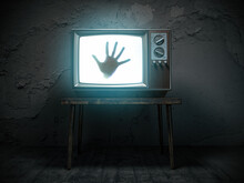 Horror Scary Movie Concept. Hand Of Ghost On Screen Of Vintage Tv In Haunted House.
