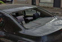 Damaged Car With Smashed Rear Window Waiting Repair At An Auto Panel Garage.