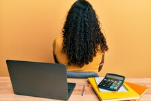 Young African American Girl Working At The Office With Laptop And Calculator Standing Backwards Looking Away With Crossed Arms