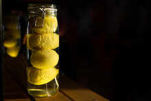 Big Jar Of Whole Canned Lemons On A Dark Background