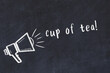 Chalk sketch of loudspeaker and inscription cup of tea