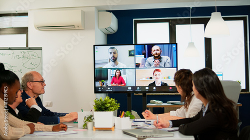 Fotografia, Obraz Headshot screen application view of remote multiracial employees talking on vide