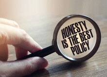 Honesty Is The Best Policy Messageunder Magnifying Glass In Hand. Marketing Business Concept