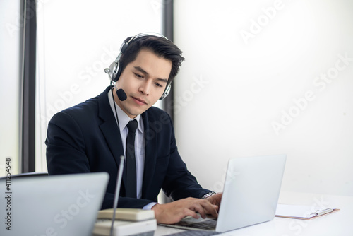 Fotografie, Obraz Asian man service Agent speak with a customer call center at the office