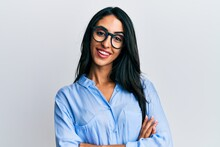 Beautiful Hispanic Woman Wearing Business Clothes And Glasses Happy Face Smiling With Crossed Arms Looking At The Camera. Positive Person.